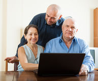 Men and woman at home online Royalty Free Stock Photography