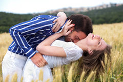 Men and woman hugging Stock Images