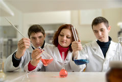Men and woman  in laboratory Stock Images