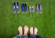 Men and woman legs with shoes standing  on grass Royalty Free Stock Image
