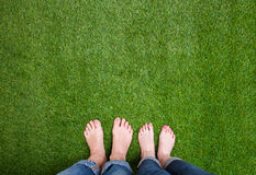 Men and woman  legs standing together on grass Royalty Free Stock Photography