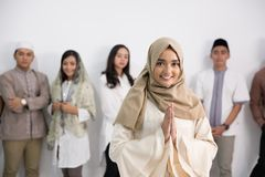 Men and woman muslim eid mubarak. Group of muslim asian men and women smiling and greeting. embracing each other during eid mubarak celebration Stock Photography