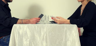 Men and woman playing with the  phones Royalty Free Stock Photo