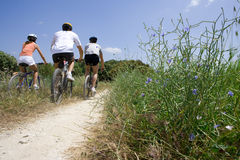 Men and woman riding bicycles on rural path Royalty Free Stock Photo