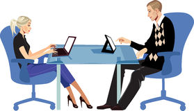 Men and woman sitting at table with laptop and tablet Royalty Free Stock Photo