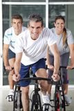 Men And Woman On Spinning Bikes Stock Photography