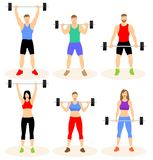 Men and women with barbell royalty free stock photos