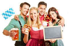 Men and women in bavaria holding Royalty Free Stock Image