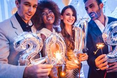 Men and women celebrating the new year 2019 royalty free stock photos