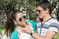 Men and women with cigarette in the park Royalty Free Stock Photo