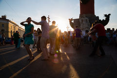 Men and women dance to Latin music on the Vasilyevsky Island in Royalty Free Stock Image