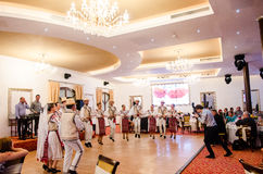 Men and women dancers performing Romanian folk dances Stock Photography