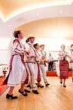Men and women dancers performing Romanian folk dances Stock Photos