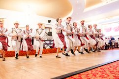 Men and women dancers performing Romanian folk dances Royalty Free Stock Photos