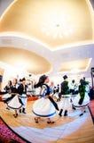 Men and women dancers performing Romanian folk dances Stock Photo