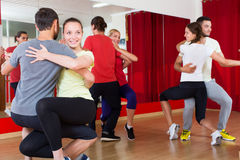 Men and women  dancing bachata together Stock Image