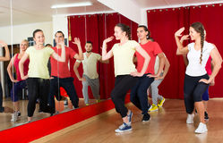 Men and women dancing in gym Stock Photo
