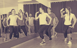 Men and women dancing in gym royalty free stock photography
