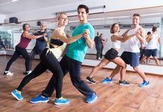 Men and women dancing salsa o bachata. Young men and women dancing a salsa o bachata at a dance hall stock photos
