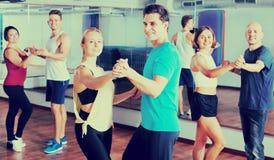 Men and women dancing salsa o bachata stock image
