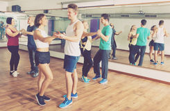 Men and women dancing salsa o bachata Stock Images