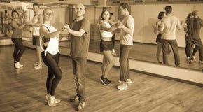 Men and women dancing salsa o bachata Royalty Free Stock Image