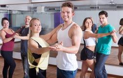 Men and women dancing salsa o bachata stock photography