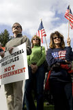 Men and women display signs at tea party rally. Royalty Free Stock Images