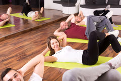 Men and women doing abs Stock Photography