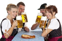 Men and women drinking Oktoberfest beer Stock Photography
