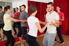 Men and women enjoying active dance Royalty Free Stock Photos