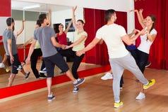 Men and women enjoying active dance Royalty Free Stock Image