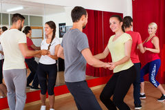 Men and women enjoying active dance Royalty Free Stock Photography