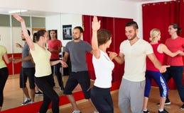 Men and women enjoying active dance Stock Photography