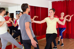 Men and women enjoying active dance Royalty Free Stock Photos