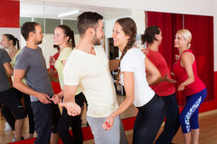 Men and women enjoying active dance Royalty Free Stock Images