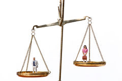 Men and women on equal scale.Symbol Royalty Free Stock Image