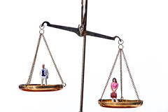 Men and women on equal scale.Symbol Stock Photography