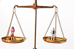 Men and women on equal Waage.Symbol stock photo