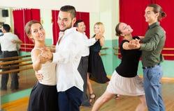 Men and women having dancing class in studio Stock Images