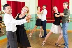 Men and women having dancing class in studio royalty free stock photos