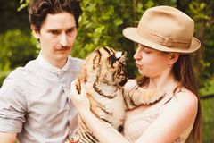 A man and woman hold tiger cub Stock Photo