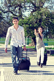 Men and women hurry with bag Stock Photography