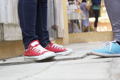 Men and women legs wearing sneakers. Royalty Free Stock Images