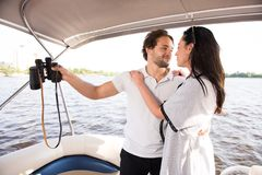 Men and women looking lovely at each other on yacht stock images