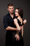 Men and women love. Hot love story. Handsome men and women passionately hugging. A loving relationship between a men and a woman. Love, passion, betrayal Stock Photography