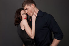 Men and women love. Hot love story. Handsome men and women passionately hugging. A loving relationship between a men and a woman. Love, passion, betrayal Royalty Free Stock Image