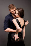 Men and women love. Hot love story. Handsome men and women passionately hugging. A loving relationship between a men and a woman. Love, passion, betrayal Royalty Free Stock Photo