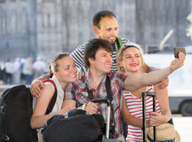 Men and women with luggage doing selfie Stock Photos