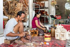 A man and a woman are making wooden crafts Stock Images